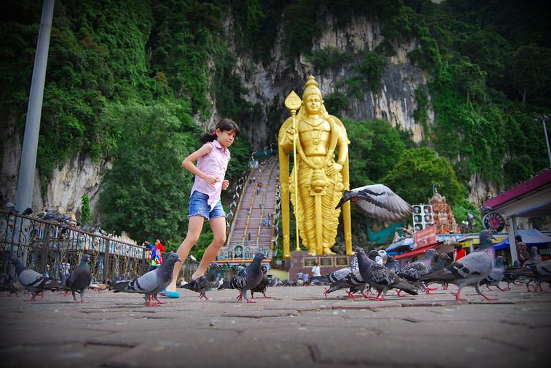 chasing pigeons at Batu Caves.jpg