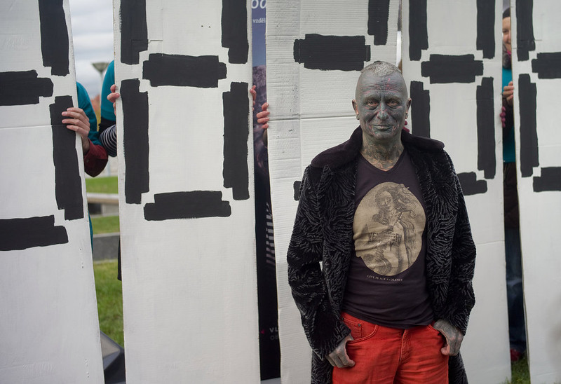 ". Picture taken on November 5, 2012 shows Czech fully-tattooed artist and drama professor Vladimir Franz poses in front of carton boards announcing his collection of 88,388 signatures to become eligible for the Czech presidential elections 2013, in Prague, Czech Republic. Despite having no political track record, Franz is running third among nine contenders, according to some opinion polls. ""The world of art gives you the capacity to speak authentically about things, you\'re not infected with the newspeak that people are so fed up with these days,\"" Franz told AFP. MICHAL CIZEK/AFP/Getty Images"