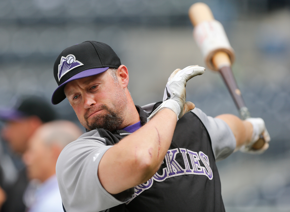 . Colorado Rockies\' Michael Cuddyer warms up for batting practice as the Rockies prepare to play the San Diego Padres in a baseball game Thursday, April 17, 2014, in San Diego. (AP Photo/Lenny Ignelzi)