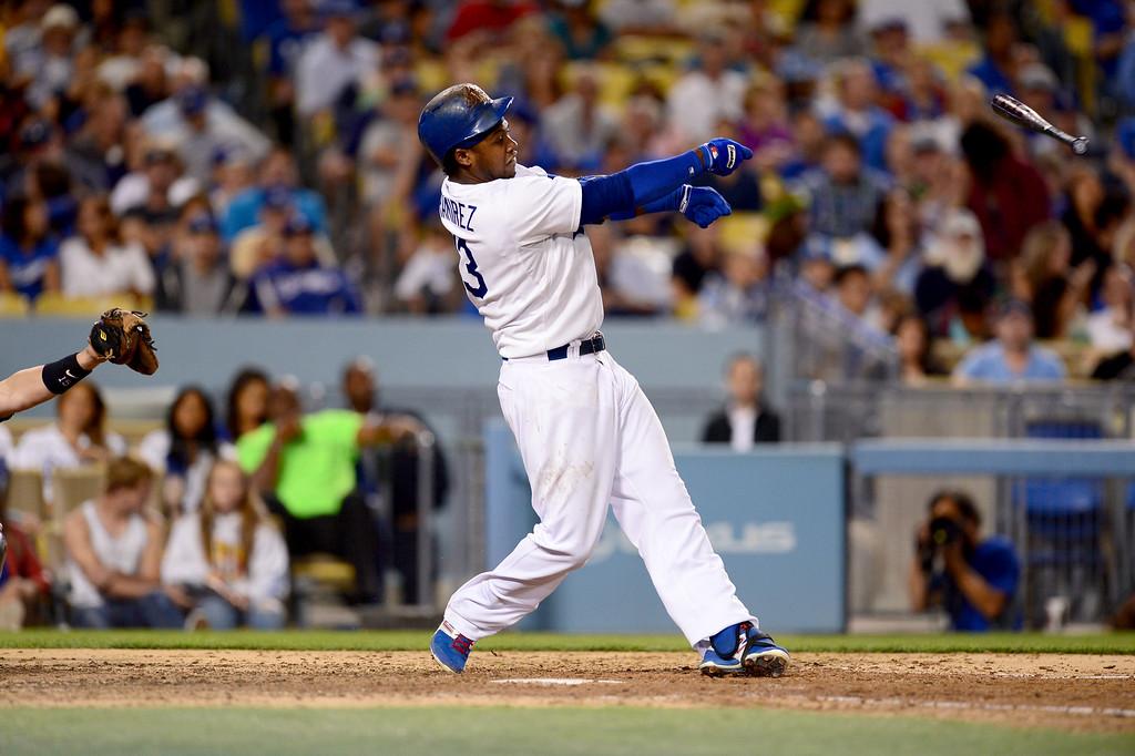 . Dodgers\' Hanley Ramirez breaks his bat as they play the Rockies at Dodger Stadium Saturday, September 28, 2013. The bat went into the crowd. (Photo by Sarah Reingewirtz/Pasadena Star-News)