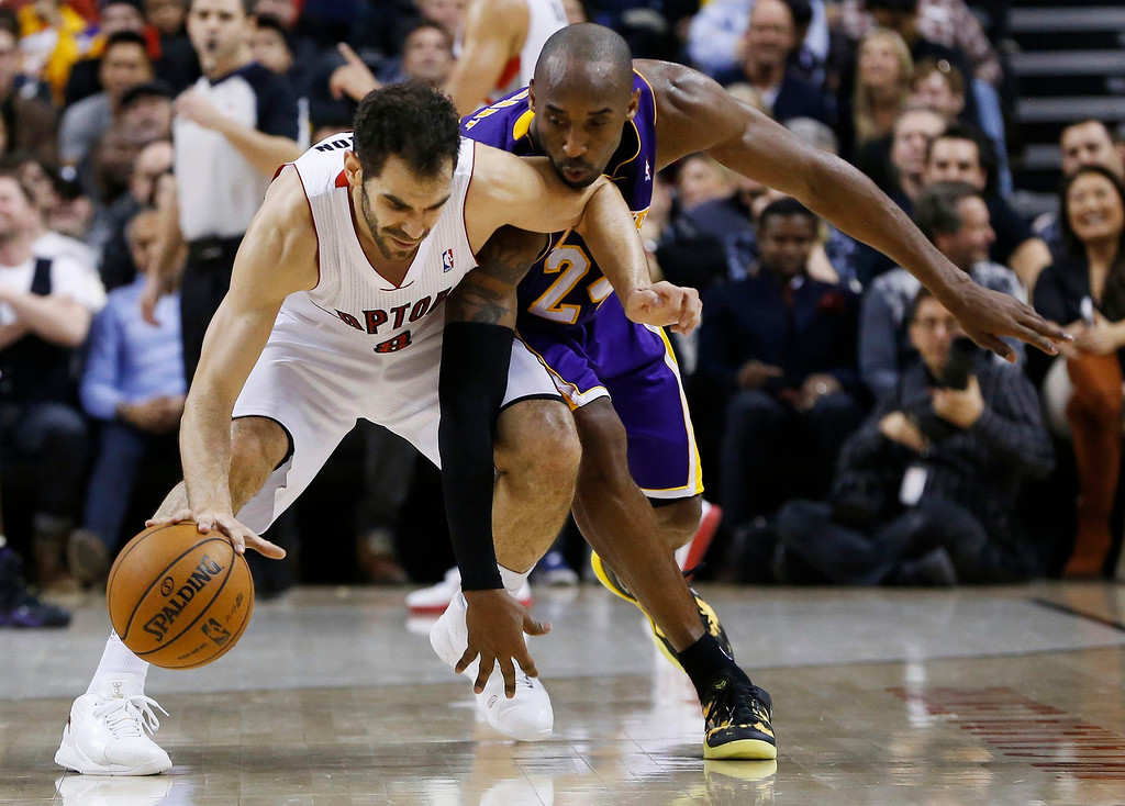 . Toronto Raptors\' Jose Calderon is guarded by Los Angeles Lakers\' Kobe Bryant (R) during the second half of their NBA basketball game in Toronto, January 20, 2013.     REUTERS/Mark Blinch