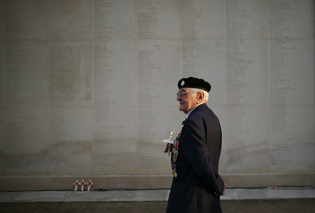 . STAFFORD, ENGLAND - AUGUST 04:  A visitor attends a Candlelit Vigil to mark the centenary of the First World War, at The National Memorial Arboretum on August 4, 2014 in Stafford, England. Monday 4th August marks the 100th anniversary of Great Britain declaring war on Germany. In 1914 British Prime Minister Herbert Asquith announced at 11pm that Britain was to enter the war after Germany had violated Belgium neutrality. The First World War or the Great War lasted until 11 November 1918 and is recognised as one of the deadliest historical conflicts with millions of causalities. A series of events commemorating the 100th anniversary are taking place throughout the day.  (Photo by Dan Kitwood/Getty Images)