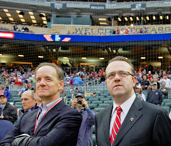 Jim Pohlad and Dave St. Peter take in the pre-game festivities on the field