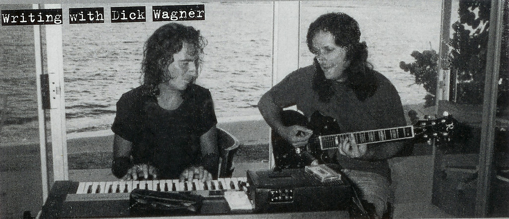 . Dick Wagner (right) writing music with Alice Cooper in 1974 .
