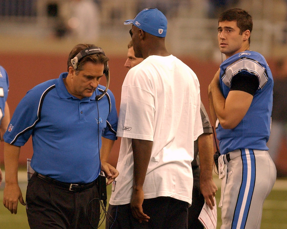 . Detroit Lions\' back-up QB Joey Harrington (3) looks at head coach Steve Mariucci during play against the Chicago Bears during the first half at Ford Field in Detroit. Photographed Sunday, Oct. 30, 2005. The Lions lost 19-13 in overtime to Chicago.