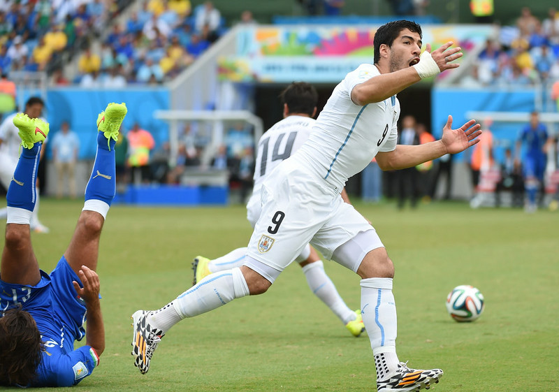 . Uruguay\'s forward Luis Suarez reacts during the Group D football match between Italy and Uruguay at the Dunas Arena in Natal during the 2014 FIFA World Cup on June 24, 2014.   EMMANUEL DUNAND/AFP/Getty Images