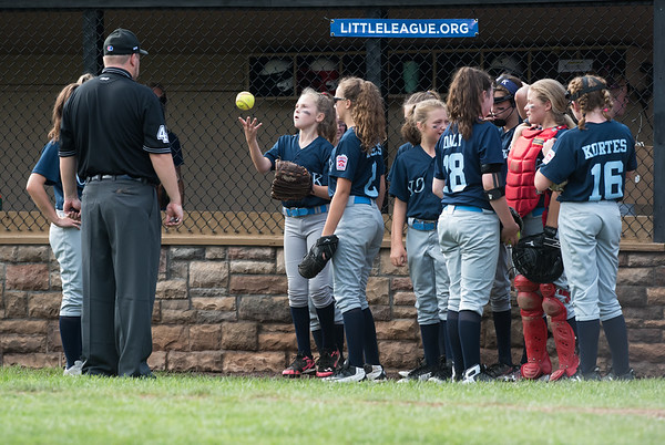 07/23/18 Wesley Bunnell | Staff Yorke, ME defeated Peabody, MA 1-0 in Little League Eastern Region Softball on Monday afternoon. York players wait before being given the ok to take the field by the umpire.