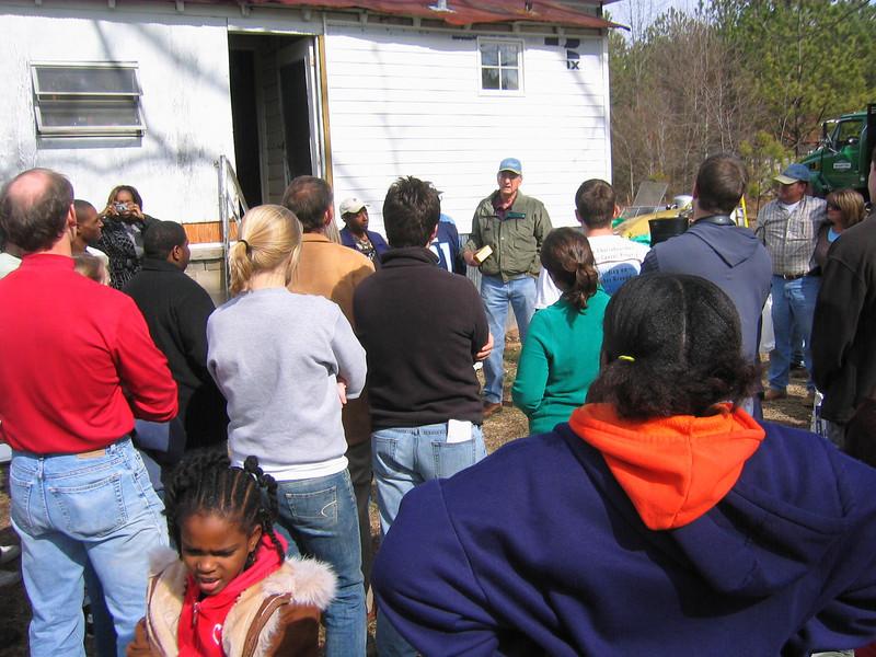 08 01 Millard Fuller speaks to group gathered at work day on Hamm renovation