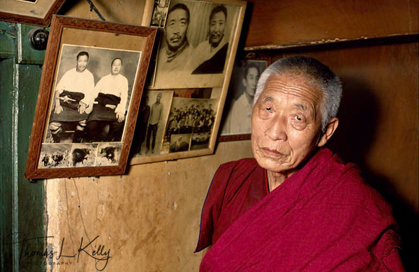 Baba Yeshi at his home at Kathmandu with portrait of Gonpo Tashi Angdrutsang on the wall behind him. Now a monk. Baba Yeshi was previously General Baba Yeshi, commander of the Tibetan Volunteer Defence Army
