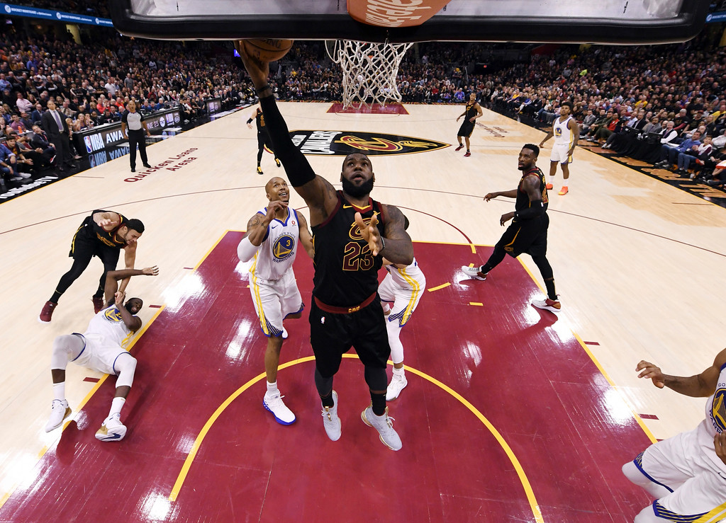 . Cleveland Cavaliers\' LeBron James (23) shoos during the first half of Game 3 of basketball\'s NBA Finals against the Golden State Warriors, Wednesday, June 6, 2018, in Cleveland. (Kyle Terada/Pool Photo via AP)