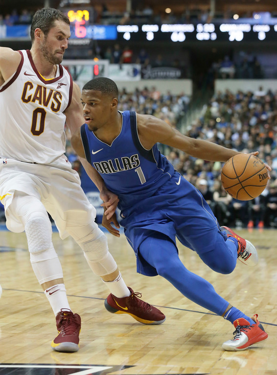 . Dallas Mavericks guard Dennis Smith Jr. (1) drives against Cleveland Cavaliers forward Kevin Love (0) during the second half of an NBA basketball game in Dallas, Saturday, Nov. 11, 2017. AP Photo/LM Otero)