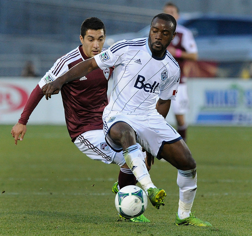 . COMMERCE CITY, CO. - OCTOBER 19: Vancouver midfielder Nigel Reo-Coker (13) controlled the ball in front of Colorado\'s Martin Rivero (10) in the second half. The Colorado Rapids defeated the Vancouver Whitecaps 3-2 at Dick\'s Sporting Goods Park Saturday, October 19, 2013. Photo By Karl Gehring/The Denver Post