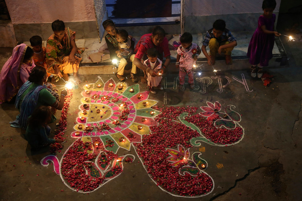 . Pakistani Hindu families decorate their house to celebrate Diwali, the Hindu festival of lights, in Karachi, Pakistan, Thursday, Oct. 19, 2017. (AP Photo/Shakil Adil)