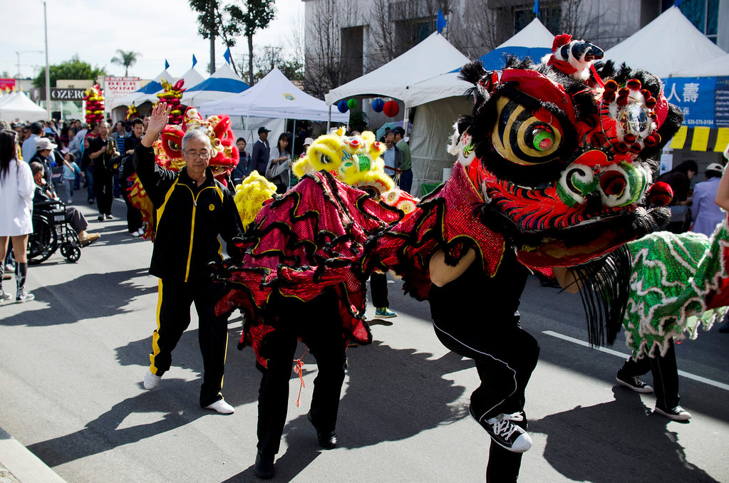 . A group of dragons make their way through the crowd at the 22nd Annual Alhambra Lunar New Year Celebration in Alhambra, Calif., Saturday, Feb. 16, 2013. The festival included food, rides, games and entertainment. (SGVN/Correspondent photo by Anibal Ortiz)