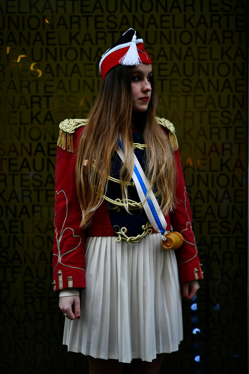 """. A female \""""Tamborillero\"""" wearing her uniform waits to take part in the traditional \'La Tamborrada\', during \'El Dia Grande\', the main day of San Sebastian feasts, in the Basque city of San Sebastian, northern Spain, Friday, Jan. 20, 2017. From midnight to midnight companies of perfectly uniformed marchers parade through the streets of San Sebastian playing drums and barrels in honor of their patron saint. (AP Photo/Alvaro Barrientos)"""