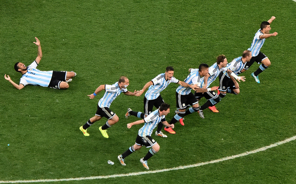 . Argentinian players celebrate after winning the semi-final football match between Netherlands and Argentina of the FIFA World Cup at The Corinthians Arena in Sao Paulo on July 9, 2014.    CHRISTOPHE SIMON/AFP/Getty Images