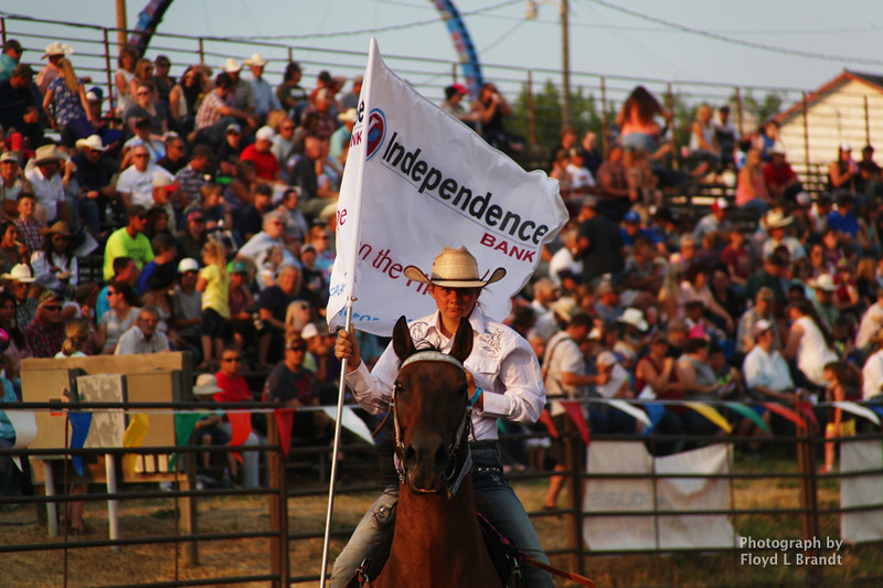 jHavre Daily News / Floyd Brandt  13 year old Mary Gibson carries a flag to mark the end and beginning of another rodeo event at The Great Northern Fair in Hill County Thursday