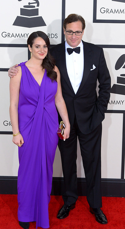 . Bob and Lara Saget arrive at the 56th Annual GRAMMY Awards at Staples Center in Los Angeles, California on Sunday January 26, 2014 (Photo by David Crane / Los Angeles Daily News)