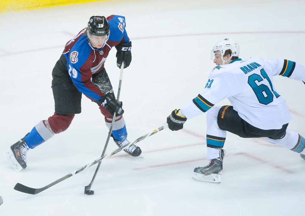 . DENVER, CO. - JANUARY 04:  Colorado center Nathan MacKinnon (29) blasted a shot past Sharks\' defenseman Justin Braun (61) in the second period. The Colorado Avalanche hosted the San Jose Sharks at the Pepsi Center Saturday afternoon, January 4, 2014. Photo By Karl Gehring/The Denver Post