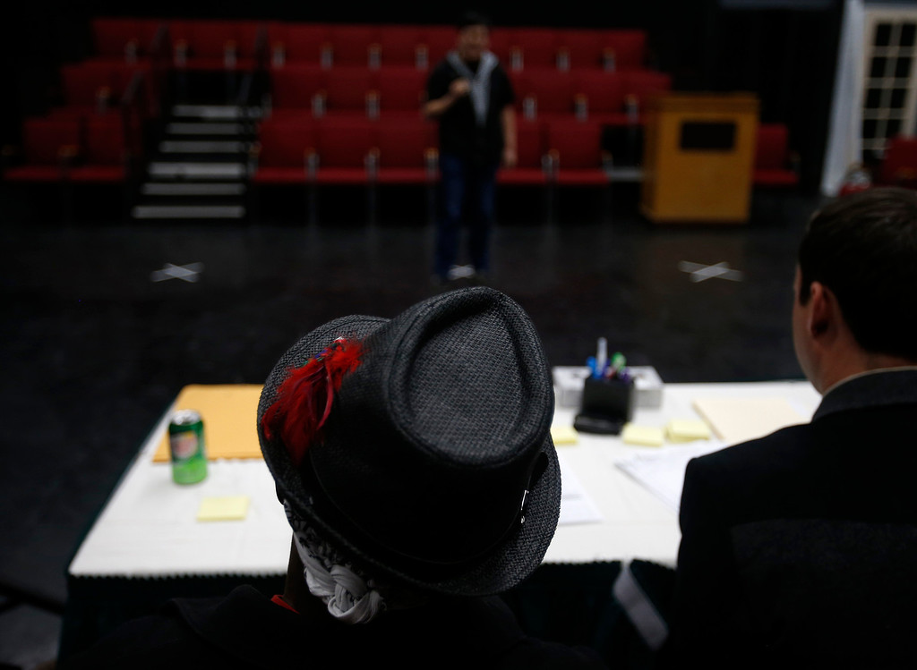 . Great America choreographer Desi Hyter, hat, listens to Joo Jun audition during a casting call for Great America theme park for their various characters and dancers in Hall Todd Theatre at San Jose State University on Wednesday, Feb. 6, 2013.  (Nhat V. Meyer/Staff)