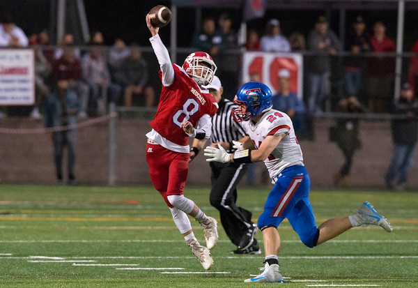 09/12/19 Wesley Bunnell | StaffrrBerlin football vs Tolland on Thursday night at Sage Park. Justin Skates (8) gets rid of the ball as he's pressured rolling right.
