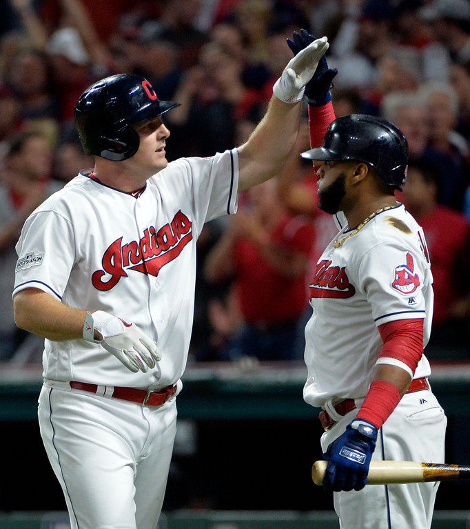 . Cleveland Indians\' Jay Bruce, right, is congratulated by Carlos Santana after Bruce hit a two-run home run off New York Yankees starting pitcher Sonny Gray in the fourth inning of Game 1 of baseball\'s American League Division Series, Thursday, Oct. 5, 2017, in Cleveland. Edwin Encarnacion scored on the play. (AP Photo/Phil Long)