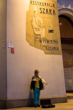 Poland, Cracow, Rynek Glowny at night  , busker