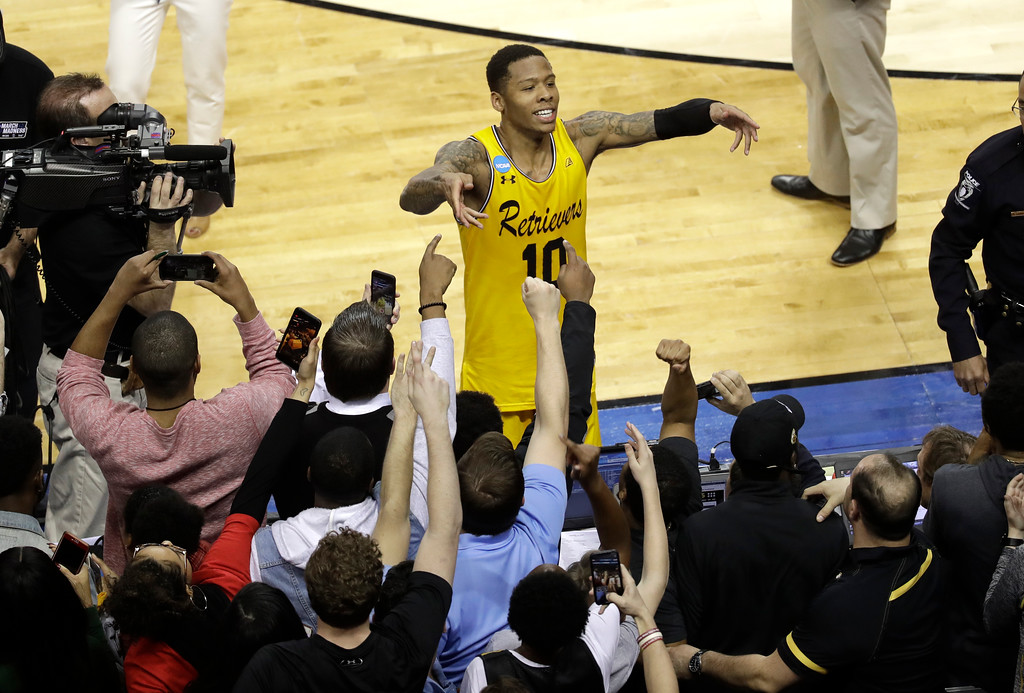 . UMBC\'s Jairus Lyles (10) celebrates with fans after the team\'s 74-54 win over Virginia in a first-round game in the NCAA men\'s college basketball tournament in Charlotte, N.C., Friday, March 16, 2018. (AP Photo/Chuck Burton)