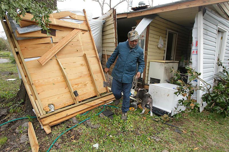 ". Semler Street resident Mack Robinson checks on his tornado damaged home Wednesday, Dec. 26, 2012, in Prichard, Ala. Robinson\'s wife, Mary, was home when the tornado hit. \""Nobody got hurt, except my feelings,\"" Robinson said. (AP Photo/AL.com, Mike Kittrell)"