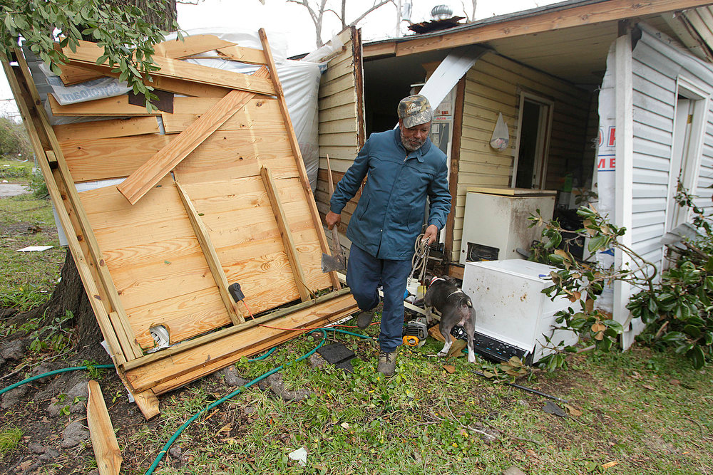 Description of . Semler Street resident Mack Robinson checks on his tornado damaged home Wednesday, Dec. 26, 2012, in Prichard, Ala. Robinson's wife, Mary, was home when the tornado hit.