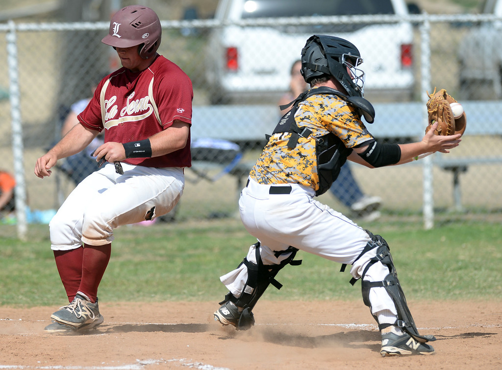 . La Serna\'s Mark Abbate (#10) scores safely as Santa Fe catcher Cameron Velasco (#14) receives a late throw in their Del Rio League game at La Serna High School in Whittier on Wednesday April 23, 2014. (Staff Photo by Keith Durflinger/Whittier Daily News)