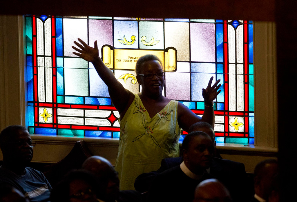 . A parishioner prays during a memorial service at Morris Brown AME Church for the people killed Wednesday during a prayer meeting inside a historic black church in Charleston, S.C., Thursday, June 18, 2015. Police arrested 21-year-old suspect Dylann Storm Roof Thursday in Shelby, N.C. without resistance. (AP Photo/David Goldman)