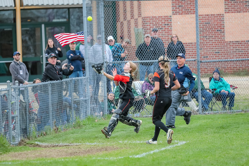 Skowhegan catcher Sydney Reed makes the catch on a fly ball near the fence.