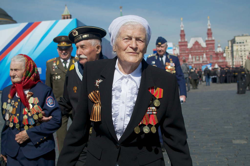 . Russian WWII veterans walk after a Victory Day parade at Red Square on Thursday, May 9, 2013. President Vladimir Putin said at the annual military parade hat Russia will be a guarantor of world security. Putin\'s short speech came at the culmination of Victory Day, marking the defeat of Nazi Germany 68 years ago. It is Russia\'s most important secular holiday, honoring the huge military and civilian losses of World War II and showing off the country\'s modern arsenal. (AP Photo/Ivan Sekretarev)