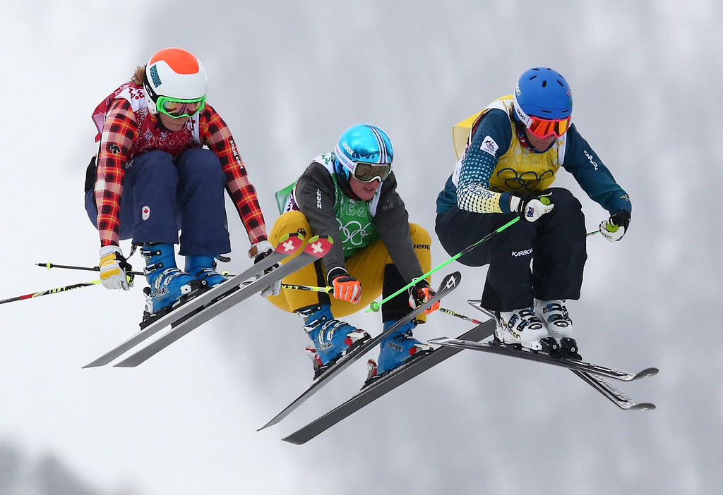 . (L-R) Georgia Simmerling of Canada, Anna Woerner of Germany and Sami Kennedy-Sim of Australia compete in the 1/8 final of the women\'s Freestyle Ski Cross event in Rosa Khutor Extreme Park at the Sochi 2014 Olympic Games, Krasnaya Polyana, Russia, 21 February 2014.  EPA/DANIEL KARMANN