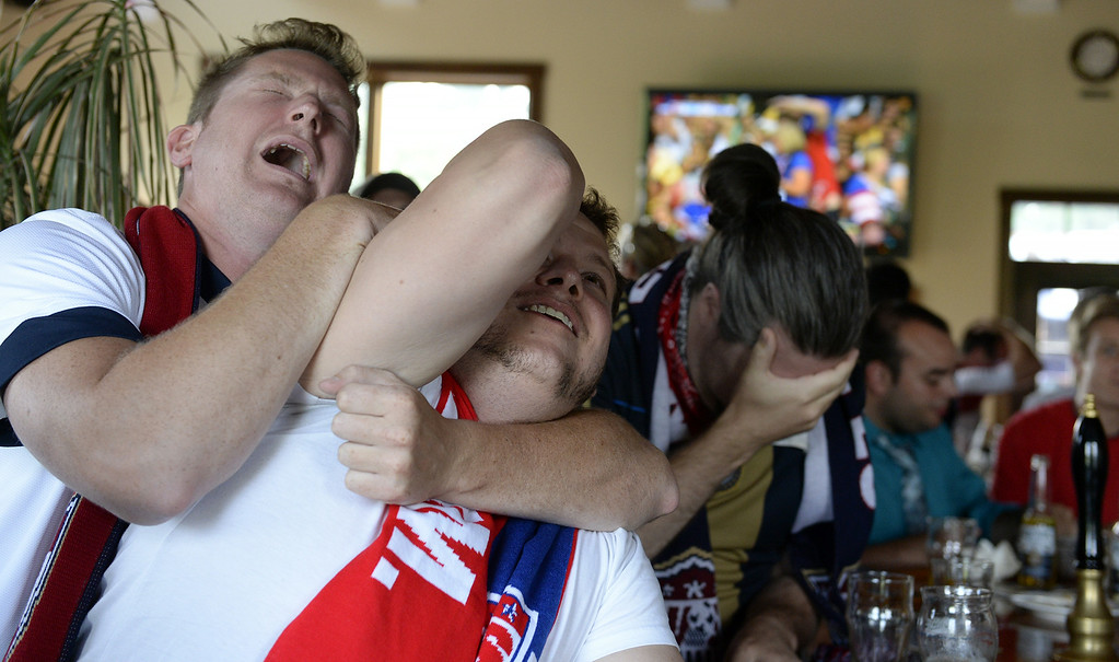 . United States soccer fans  Paul Vranesic, John Goodison and Chris Bomgardmer react during the World Cup match between the United States and Belgium on Tuesday, July 1, 2014, Cornwall, Pa. (AP Photo/Lebanon Daily News, Jeremy Long)