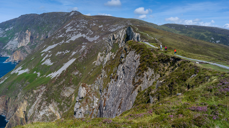 Tourists walking on hill, Slieve League, County Donegal, Ireland