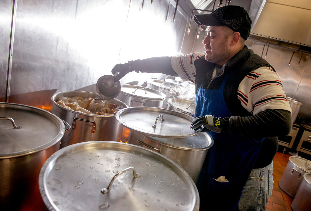 . Raul Campos adds water to cooking pots at Tamales Lilianas where thousands of tamales are sold over the Christmas season at their East Los Angeles restaurant located at 4629 East Cesar E. Chavez Ave. Dec. 23, 2013.   (Staff photo by Leo Jarzomb/San Gabriel Valley Tribune)