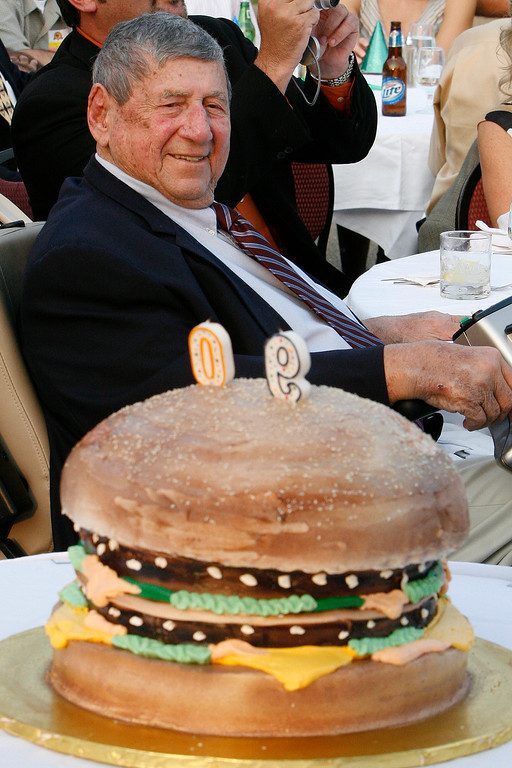 . In this Aug. 21, 2008 file photo Big Mac creator Jim Delligatti sits behind a Big Mac birthday cake at his 90th birthday party in Canonsburg, Pa.. (AP Photo/Gene J. Puskar/File)