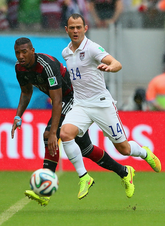 . Jerome Boateng of Germany and Brad Davis of the United States compete for the ball during the 2014 FIFA World Cup Brazil group G match between the United States and Germany at Arena Pernambuco on June 26, 2014 in Recife, Brazil.  (Photo by Kevin C. Cox/Getty Images)