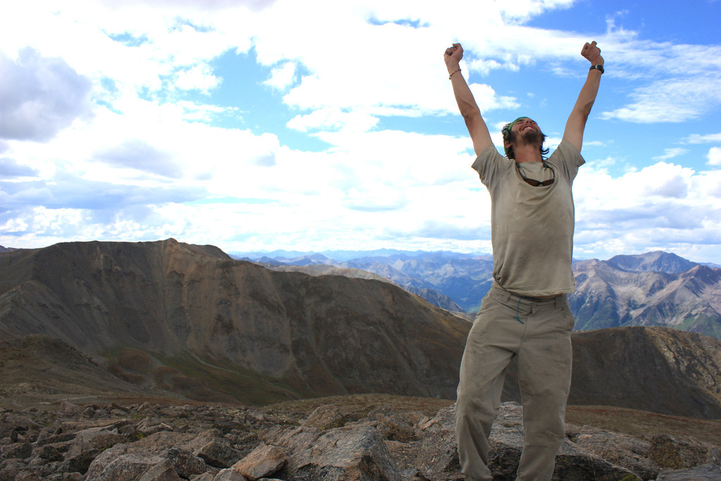 . Luke DeMuth celebrates atop Mt Oxford, the 38th peak in his and friend Junaid Dawud\'s mission to climb all 58 fourteeners in a single hike. The pair have hiked 1,300 miles and climbed 57 of the state\'s 58 14,000-foot peaks and plan to finish their 70-day mission Sunday on Longs Peak.