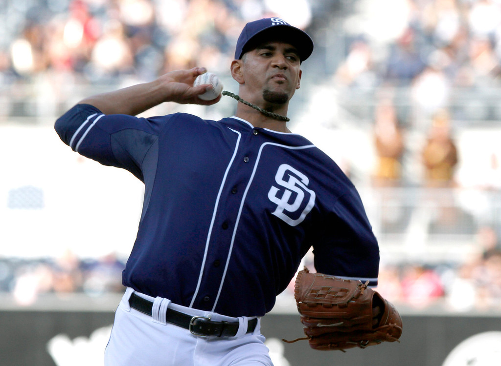 . San Diego Padres  pitcher Tyson Ross delivers against the Colorado Rockies during the first inning of a baseball game on Saturday, Sept. 7, 2013, in San Diego. (AP Photo/Don Boomer)
