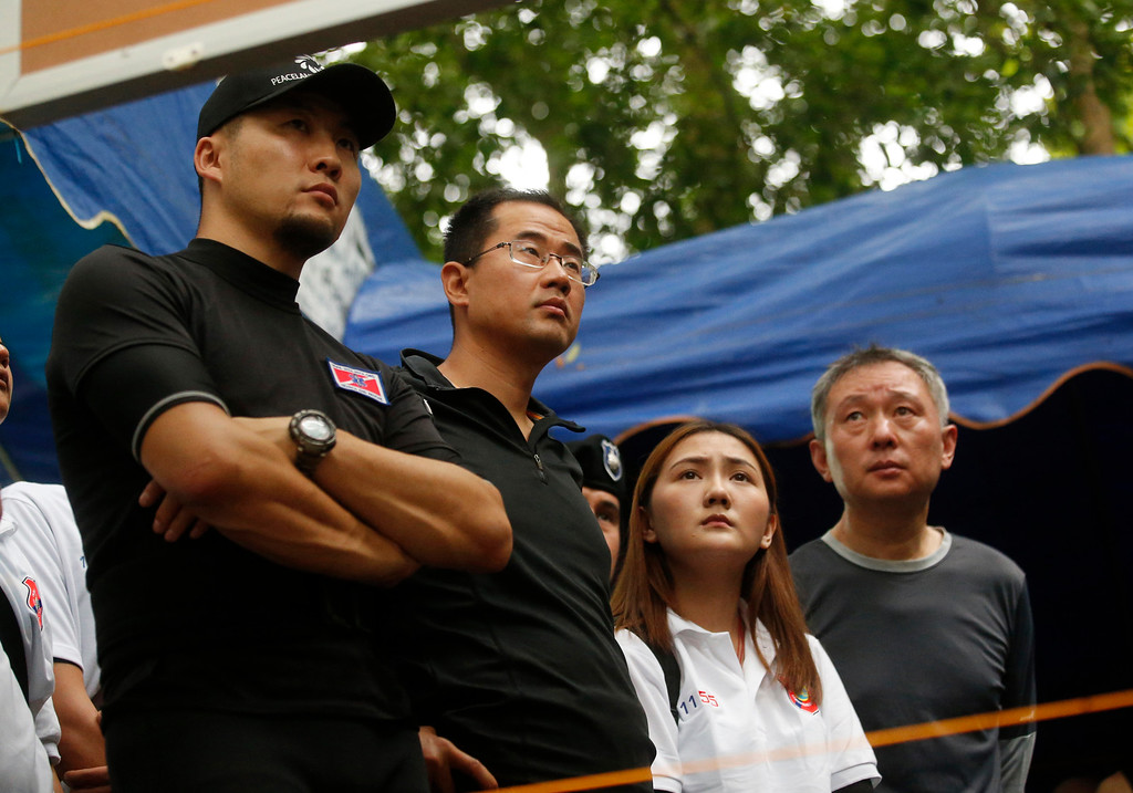 . China\'s rescue team members join in a meeting with U.S. Special Operations Command Pacific Search and Rescue team personnel as they conduct search operation for missing 12 boys and their soccer coach, in Mae Sai, Chiang Rai province, in northern Thailand, Monday, July 2, 2018. Rescue divers are advancing in the main passageway inside the flooded cave in northern Thailand where the boys and their coach have been missing more than a week. (AP Photo/Sakchai Lalit)