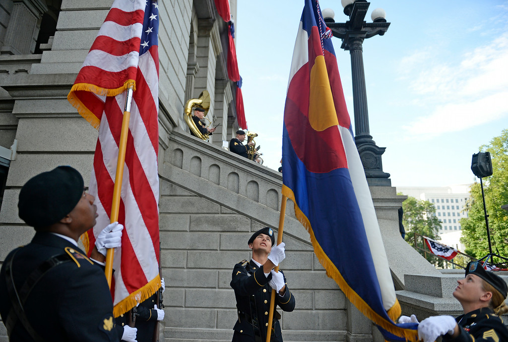 . Colorado Army National Guard Band Color Guard gets the Colorado flag ready for posting during a celebration, for the 138th anniversary of the state of Colorado, on the west steps of Colorado State Capitol in Denver, August 01, 2014. The celebration included dancing, a cake, historical remarks, and more. (Photo by RJ Sangosti/The Denver Post)