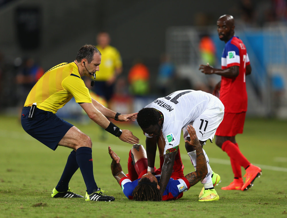Description of . Sulley Muntari of Ghana reacts angrily after a challenge by Alejandro Bedoya of the United States as referee Jonas Eriksson runs on during the 2014 FIFA World Cup Brazil Group G match between Ghana and the United States at Estadio das Dunas on June 16, 2014 in Natal, Brazil.  (Photo by Michael Steele/Getty Images)