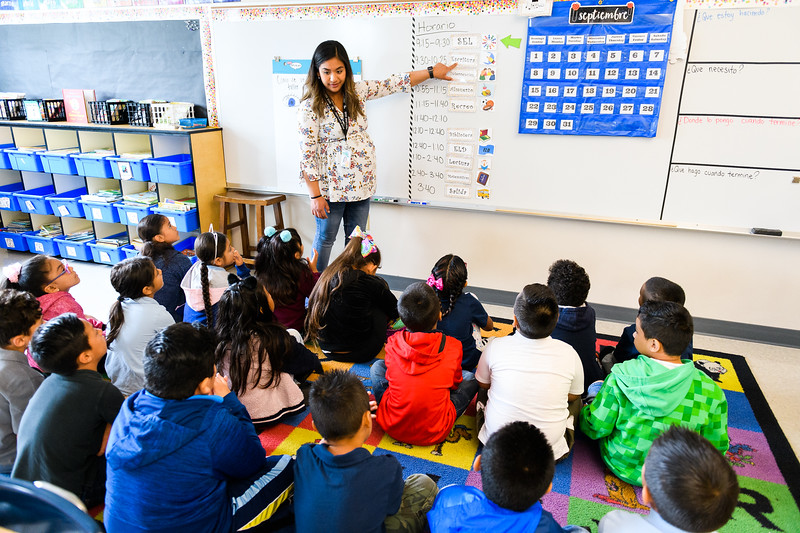 Second-grade teacher Escarlett Trujillo-Caldera teaches her class the schedule. Back to school day at Hallman Elementary School on Wednesday, September 4, 2019 in Salem, Ore.