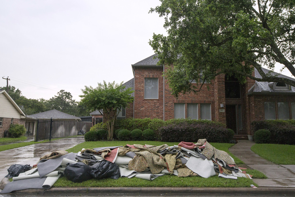 . Damaged homes sit with discarded carpet following massive flooding May 27, 2015 in Houston, Texas.  At least 18 people have been killed across Texas and Oklahoma after severe weather, including catastrophic flooding and tornadoes, has struck over the past several days. (Photo by Eric Kayne/Getty Images)