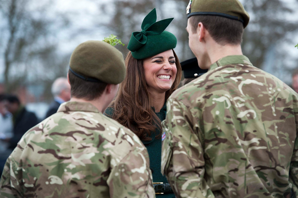 . Catherine, Duchess of Cambridge speak with soldiers while visiting the Irish Guards during a St Patrick\'s Day parade in Mons Barracks in Aldershot on March 17, 2014. Prince William, the Duke of Cambridge attended the parade as Colonel of the Regiment and Catherine presented the traditional sprigs of shamrocks to the Officers and Guardsmen of the Regiment. The Duke and Duchess of Cambridge visit the 1st Battalion Irish Guards at the St. Patricks Day Parade at Mons Barracks Aldershot.  AFP PHOTO/POOL/BRADLEY PAGE/AFP/Getty Images