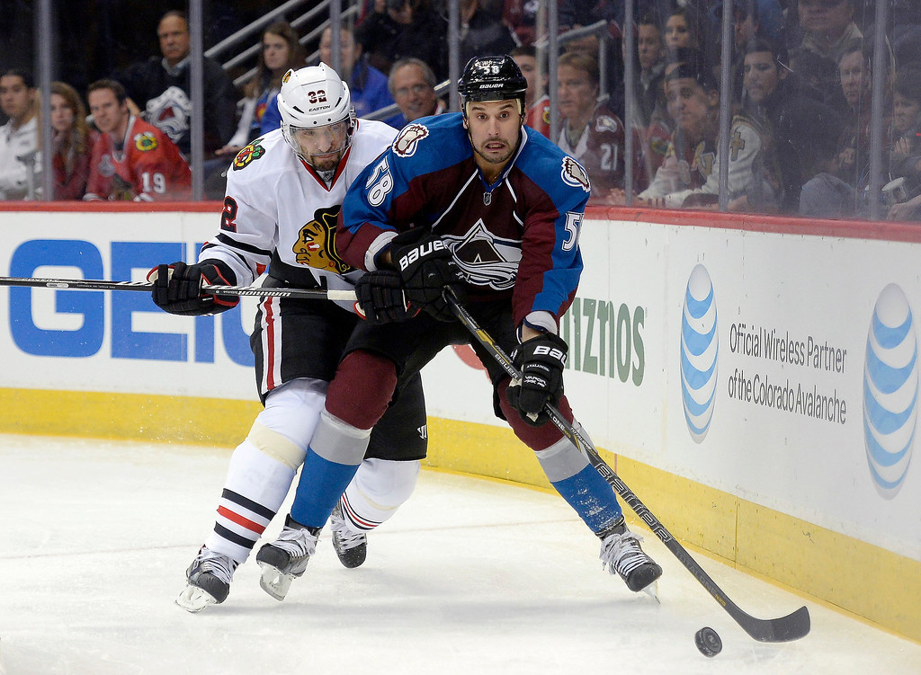 . Colorado Avalanche left wing Patrick Bordeleau (58) races to the puck as Chicago Blackhawks defenseman Michal Rozsival (32) follows in defense during the first period November 19, 2013 at Pepsi Center. (Photo by John Leyba/The Denver Post)