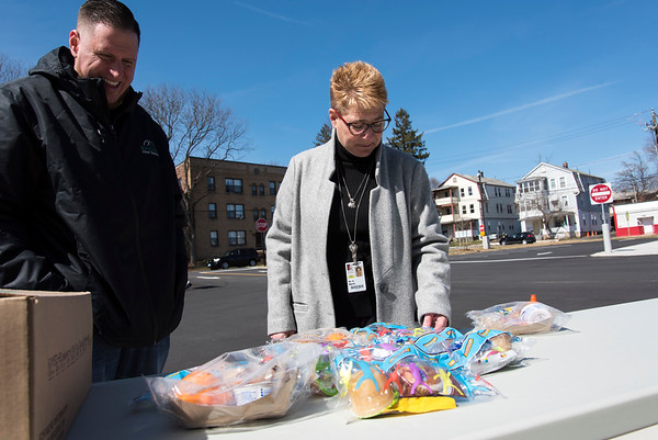 03/16/20 Wesley Bunnell | StaffrrSchool lunches are being provided at no charge to New Britain residents in the wake of forced school closings due to the Coronavirus. Standing outside of Smalley School on Monday March 16, 2020 are eJeff Taddeo, Resident District manger for Whitsons School Nutrition, L, as he looks over the specially packaged cold lunches available along with CSDNB Superintendent of Schools Nancy Sarra.